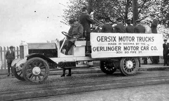 Publicity for Gersix truck ca. 1916 while a band plays in the rear.