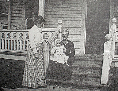 Grace Worthington (seated), Ellen, and baby Kenneth Worthington circa 1909 at the West side entrance porch in vintage family photo.